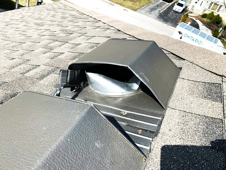 Image of a roof vent broken by raccoons